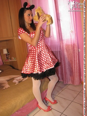 Young slut in red spotted dress and heels pose nicely on a spread bed. - XXXonXXX - Pic 2