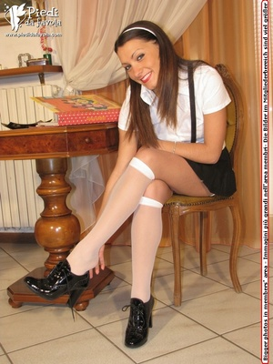 Exotic girl in black short skirt and white top with heels poss seductively on a seat. - XXXonXXX - Pic 4