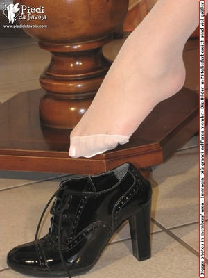 Exotic girl in black short skirt and white top with heels poss seductively on a seat. - XXXonXXX - Pic 5