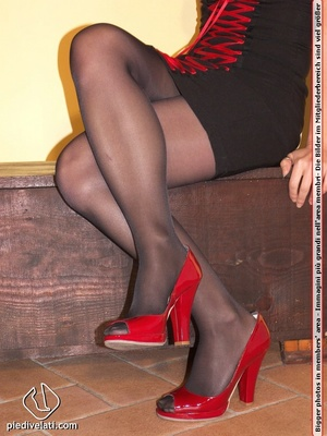 Cute redhead in red and black dress models hot feet in black hose and red shoes - XXXonXXX - Pic 3