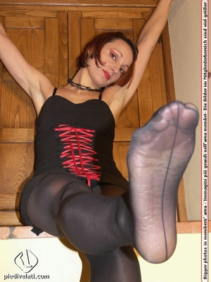Cute redhead in red and black dress models hot feet in black hose and red shoes - XXXonXXX - Pic 11