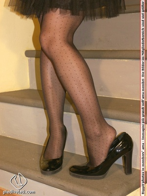 Hot chick on stairs in short skirt and top displays feet and legs in black hose - XXXonXXX - Pic 6
