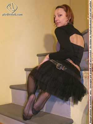 Hot chick on stairs in short skirt and top displays feet and legs in black hose - XXXonXXX - Pic 9