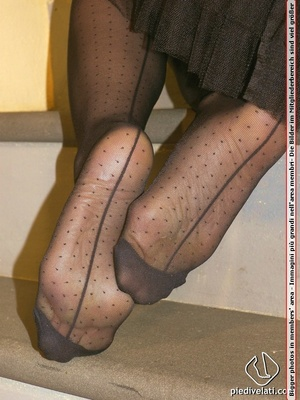 Hot chick on stairs in short skirt and top displays feet and legs in black hose - XXXonXXX - Pic 10