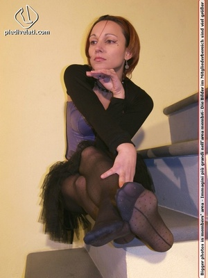 Hot chick on stairs in short skirt and top displays feet and legs in black hose - XXXonXXX - Pic 11