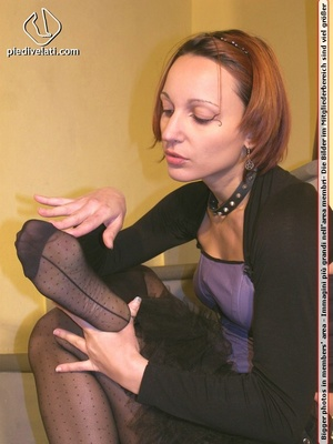 Hot chick on stairs in short skirt and top displays feet and legs in black hose - XXXonXXX - Pic 13