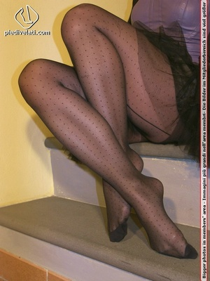 Hot chick on stairs in short skirt and top displays feet and legs in black hose - XXXonXXX - Pic 15