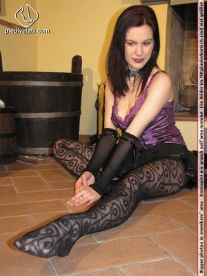 Charming brunette in purple top, black skirt and shoes shows feet in black hose - XXXonXXX - Pic 1