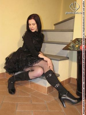 Hot chick in black outfit and boots shows sexy legs and feet in black pantyhose - XXXonXXX - Pic 1