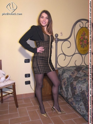 Smiling damsel in cute short dress displays legs and feet in black hose on bed - XXXonXXX - Pic 1
