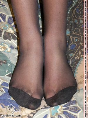 Smiling damsel in cute short dress displays legs and feet in black hose on bed - XXXonXXX - Pic 6