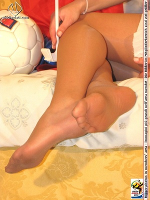 Cute sports babe in blue and white jersey removes socks to show seductive feet - XXXonXXX - Pic 10
