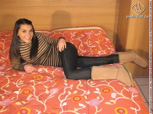 Chick in stripped top and long pants models sexy feet in flesh colored hose on bed - XXXonXXX - Pic 1