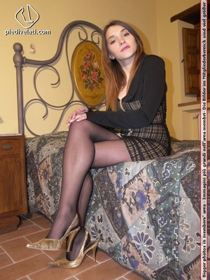 Hot chick in short sexy black dress displays long legs and sexy feet on bed - XXXonXXX - Pic 2
