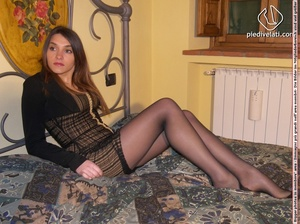 Hot chick in short sexy black dress displays long legs and sexy feet on bed - XXXonXXX - Pic 7