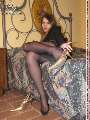 Hot chick in short sexy black dress displays long legs and sexy feet on bed - XXXonXXX - Pic 12