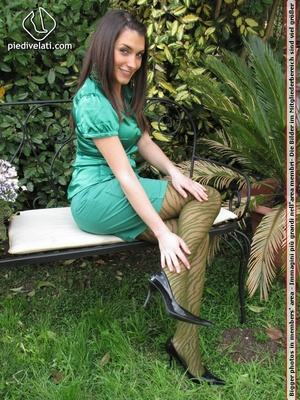 Young seductress in green dress, pantyhose and black shoes shows feet outdoors - XXXonXXX - Pic 2