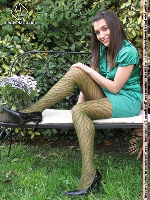 Young seductress in green dress, pantyhose and black shoes shows feet outdoors - XXXonXXX - Pic 3