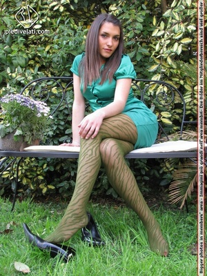 Young seductress in green dress, pantyhose and black shoes shows feet outdoors - XXXonXXX - Pic 5