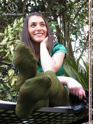 Young seductress in green dress, pantyhose and black shoes shows feet outdoors - XXXonXXX - Pic 9