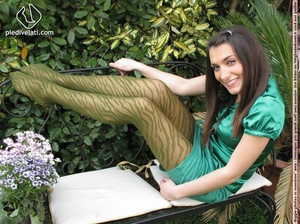 Young seductress in green dress, pantyhose and black shoes shows feet outdoors - XXXonXXX - Pic 10