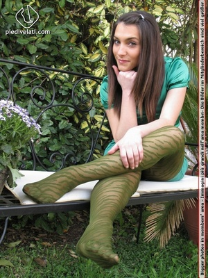 Young seductress in green dress, pantyhose and black shoes shows feet outdoors - XXXonXXX - Pic 11