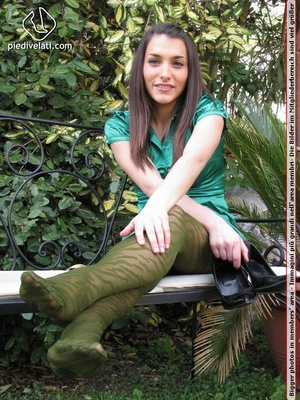 Young seductress in green dress, pantyhose and black shoes shows feet outdoors - XXXonXXX - Pic 15