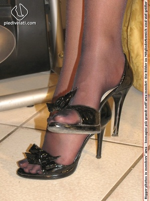 Beauty in spicy short black dress and black pantyhose shows feet on yellow sofa - XXXonXXX - Pic 2