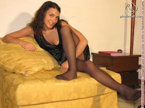 Beauty in spicy short black dress and black pantyhose shows feet on yellow sofa - XXXonXXX - Pic 10