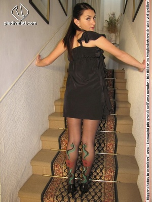 Naughty chick in sexy black dress shows hot long legs and feet in colorful hose - XXXonXXX - Pic 4