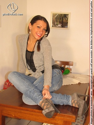 Cute chick in tight blue jeans drops shoes to display sweet cute feet on table - XXXonXXX - Pic 2