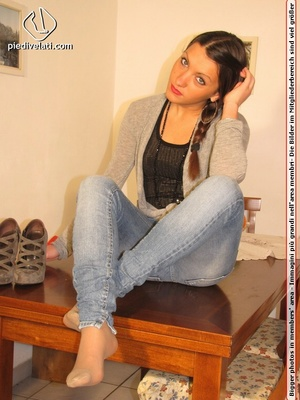 Cute chick in tight blue jeans drops shoes to display sweet cute feet on table - XXXonXXX - Pic 4
