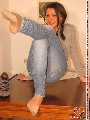 Cute chick in tight blue jeans drops shoes to display sweet cute feet on table - XXXonXXX - Pic 5