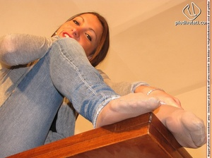 Cute chick in tight blue jeans drops shoes to display sweet cute feet on table - XXXonXXX - Pic 7