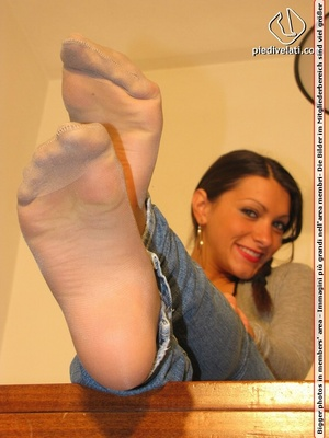 Cute chick in tight blue jeans drops shoes to display sweet cute feet on table - XXXonXXX - Pic 10