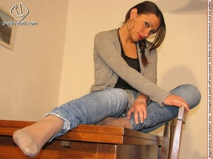 Cute chick in tight blue jeans drops shoes to display sweet cute feet on table - XXXonXXX - Pic 13