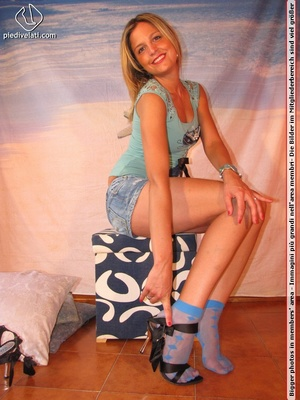 Cute blonde in short skirt, blue socks and top drops socks to reveal sweet feet - XXXonXXX - Pic 10