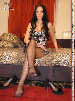 Long hair brunette in sexy white and black dress shows cute feet in black nylon - XXXonXXX - Pic 5