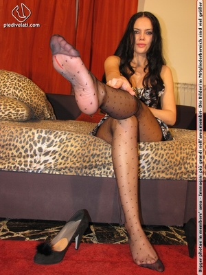 Long hair brunette in sexy white and black dress shows cute feet in black nylon - XXXonXXX - Pic 7