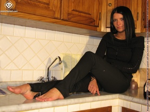 Sweet looking babe in black shows off naked charming feet in the kitchen - XXXonXXX - Pic 4