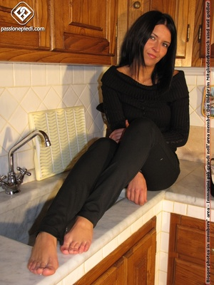 Sweet looking babe in black shows off naked charming feet in the kitchen - XXXonXXX - Pic 5
