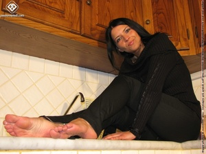 Sweet looking babe in black shows off naked charming feet in the kitchen - XXXonXXX - Pic 6