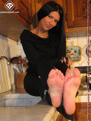 Sweet looking babe in black shows off naked charming feet in the kitchen - XXXonXXX - Pic 7