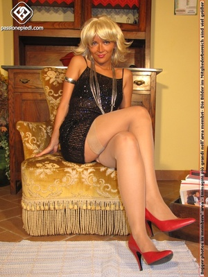 Hot blonde in black rolls off skin colored tights to reveal manicured sexy feet - XXXonXXX - Pic 1