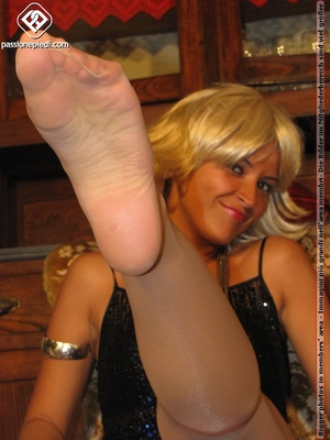 Hot blonde in black rolls off skin colored tights to reveal manicured sexy feet - XXXonXXX - Pic 3