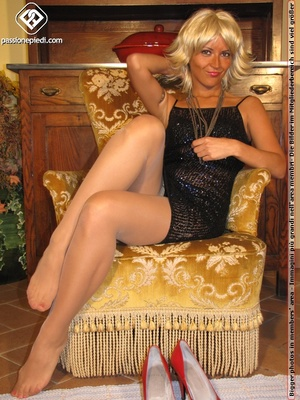 Hot blonde in black rolls off skin colored tights to reveal manicured sexy feet - XXXonXXX - Pic 5