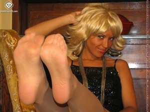 Hot blonde in black rolls off skin colored tights to reveal manicured sexy feet - XXXonXXX - Pic 7