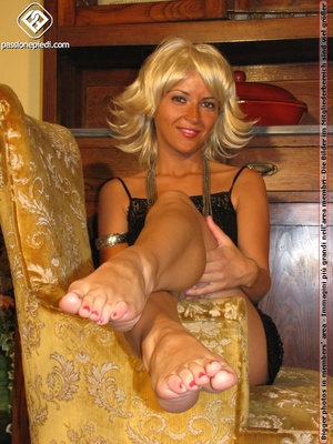 Hot blonde in black rolls off skin colored tights to reveal manicured sexy feet - XXXonXXX - Pic 9