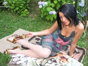 Charming black hair chick shows off sexy legs and feet in white pantyhose outdoors - XXXonXXX - Pic 2