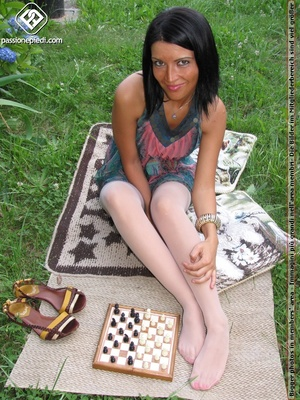Charming black hair chick shows off sexy legs and feet in white pantyhose outdoors - XXXonXXX - Pic 6